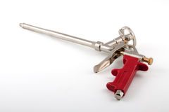 Pistol for building foam. On a white background Stock Images