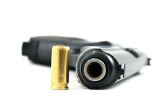 Pistol and bullet. ( focus on the gunpoint royalty free stock photos