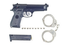 Pistol bullet magazine and handcuff . Stock Images