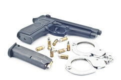 Pistol bullet magazine and handcuff . Royalty Free Stock Photos