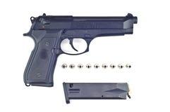 Pistol bullet and magazine . Royalty Free Stock Photo