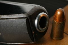 Bullet and gun scene. The pistol and bullet scene represent the weapon abstract concept related idea Stock Photography