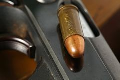Bullet and gun scene. The pistol and bullet scene represent the weapon abstract concept related idea Royalty Free Stock Image