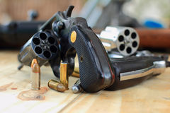 Pistol and bullet. On table wooden Stock Images