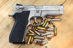 Pistol and bullet. On table wooden Stock Image
