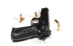 Pistol and bullets Stock Images