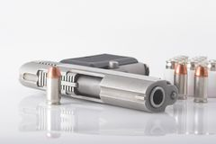 Pistol and bullets. Semi automatic handgun and pistol cartridges Royalty Free Stock Photos