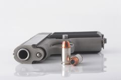 Pistol and bullets. Semi automatic handgun and pistol cartridges Royalty Free Stock Image