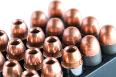 .45 Pistol bullets in a cartridge holder. Royalty Free Stock Photography
