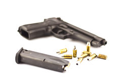 Pistol & bullets isolate. Stock Images