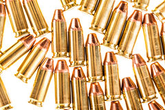 Pistol bullets isolated on white. A bunch of 9mm handgun bullets cartridges isolated over a white background Stock Image