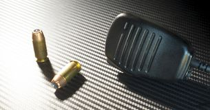 Pistol bullets and microphone Royalty Free Stock Images