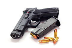 Pistol and bullets. On white background Royalty Free Stock Images