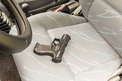 Pistol in the car. Well visible pistol in the car Stock Photo