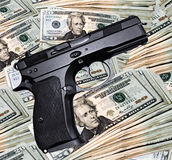 Pistol & cash royalty free stock image