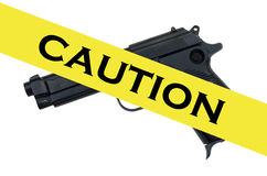 Pistol and caution tape Royalty Free Stock Image