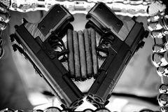 Pistol and cigars Royalty Free Stock Photography
