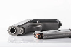 Pistol and clip. Handgun and magazine loaded with cartridges Stock Photography