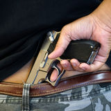 Pistol Concealed in a Man's Waistband.  Stock Images