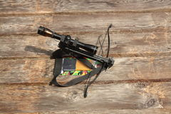 Pistol cross bow. Pistol stlye cross bow with plank background Stock Photos