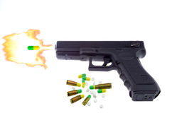 Pistol and drugs Stock Photo