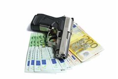 Pistol on euro Royalty Free Stock Photo