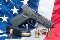 Pistol on flag Stock Image