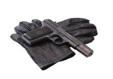 Pistol On Gloves Stock Image