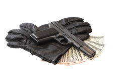 Pistol On Gloves And Money Royalty Free Stock Photography