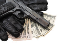 Pistol On Gloves And Money Royalty Free Stock Photo