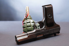 Pistol And Grenades Royalty Free Stock Images