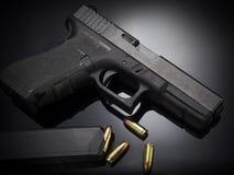 Pistol gun on black background Stock Images