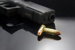 Pistol gun on black background Royalty Free Stock Photos