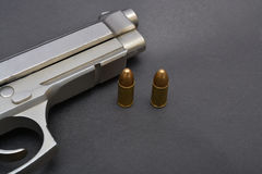 Pistol gun and bullets on black background.  Royalty Free Stock Image