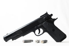 Pistol Gun and Bullets Stock Photos