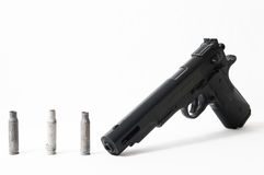 Pistol Gun and Bullets Stock Images