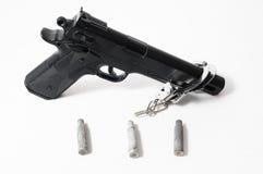 Pistol Gun and Bullets Royalty Free Stock Photo