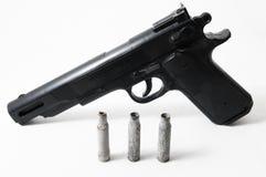 Pistol Gun and Bullets Stock Photo