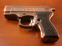 Pistol, gun-cigarette-lighter Royalty Free Stock Images