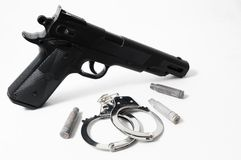 Pistol Gun and Handcuffs Royalty Free Stock Photography