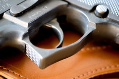 Pistol or gun trigger. And brown  leather holster Stock Images