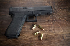 Pistol gun on wooden background Stock Image