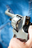 Pistol in hand Royalty Free Stock Image