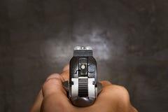 Pistol hand gun shooting Royalty Free Stock Image