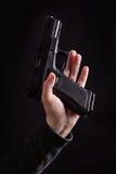 Pistol in hand Stock Photos