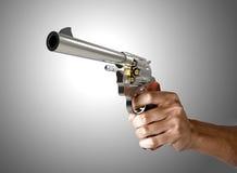 Pistol in hand Stock Photo