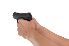 Pistol. In hand isolated on white background Stock Images