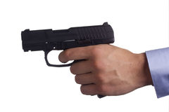 Pistol in hand royalty free stock photography