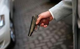 Pistol in a hand Royalty Free Stock Images