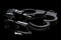 Pistol with handcuffs Stock Image